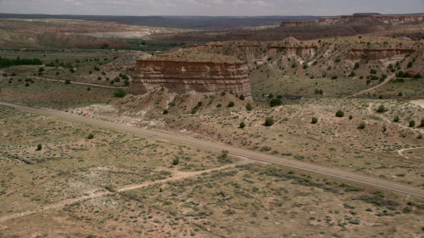 Flying by butte, Highway 89, Glen Canyon National Recreation Area, Utah, Arizona Aerial Stock Footage AX131_098