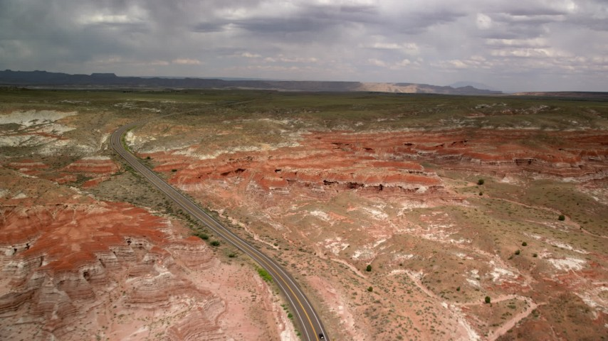 6K stock footage aerial video of following Highway 89 toward rock formations, Glen Canyon National Recreation Area, Utah, Arizona Aerial Stock Footage | AX131_101