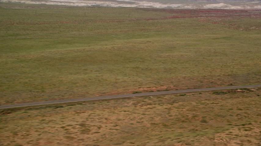 6K stock footage aerial video of deserted Highway 89 through desert plain, Glen Canyon National Recreation Area, Utah, Arizona Aerial Stock Footage | AX131_104