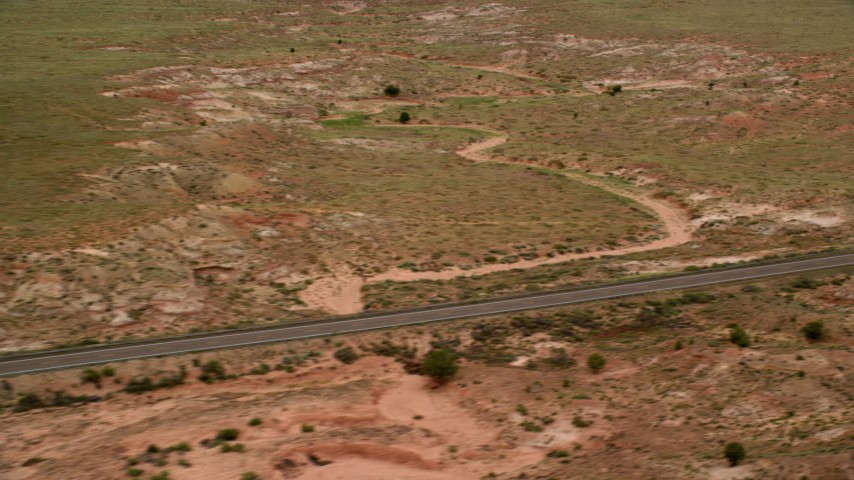 Fly by deserted Highway 89, Glen Canyon National Recreation Area, Utah, Arizona Aerial Stock Footage | AX131_105