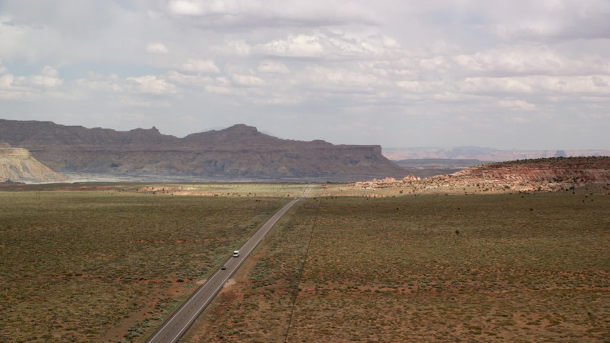 6K stock footage aerial video wide view of Highway 89 and desert plain, Glen Canyon National Recreation Area, Utah, Arizona Aerial Stock Footage | AX131_108