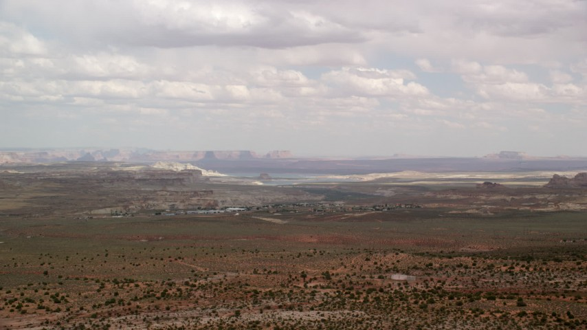 6K stock footage aerial video of approaching small rural town, open desert, Big Water, Utah Aerial Stock Footage | AX131_115