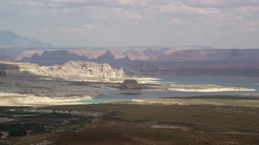 6K stock footage aerial video of Lone Rock and Lake Powell by Glen Canyon National Recreation Area, Utah, Arizona Aerial Stock Footage | AX131_121