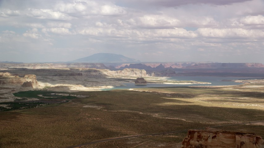 6K stock footage aerial video of passing Lone Rock and Lake Powell by Glen Canyon National Recreation Area, Utah, Arizona Aerial Stock Footage | AX131_122