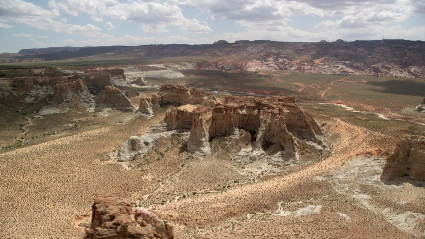 6K stock footage aerial video of flying by rocky buttes at Glen Canyon National Recreation Area, Utah, Arizona Aerial Stock Footage | AX131_123