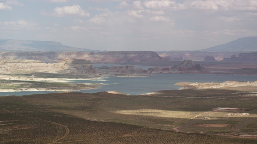 Flying by Lake Powell, Glen Canyon National Recreation Area, Utah, Arizona Aerial Stock Footage | AX131_125