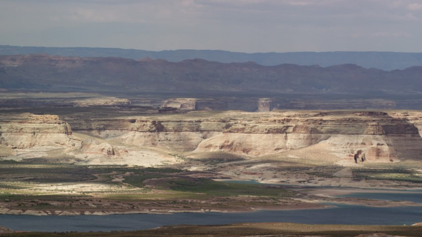 6K stock footage aerial video of flying by mesa and Lake Powell, Glen Canyon National Recreation Area, Utah, Arizona Aerial Stock Footage | AX131_128