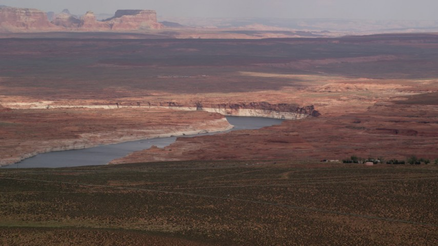 Flying by Lake Powell, Glen Canyon National Recreation Area, Utah, Arizona Aerial Stock Footage | AX131_129