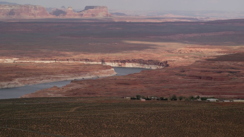 6K stock footage aerial video of passing by Lake Powell and desert, Glen Canyon National Recreation Area, Utah, Arizona Aerial Stock Footage | AX131_130