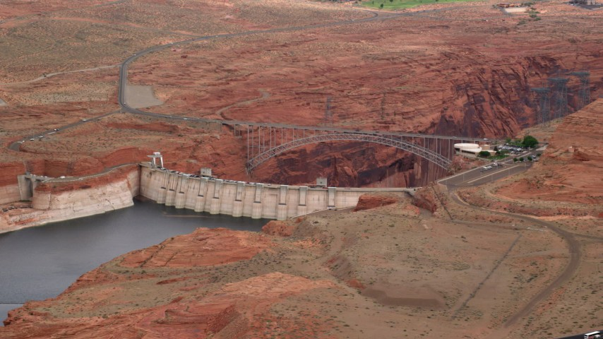 Flying by the Glen Canyon Dam and Bridge, Arizona Aerial Stock Footage | AX131_132