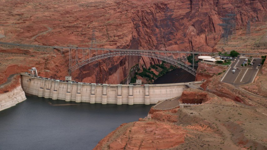 6K stock footage aerial video of passing by Glen Canyon Dam and Bridge, Arizona Aerial Stock Footage | AX131_133