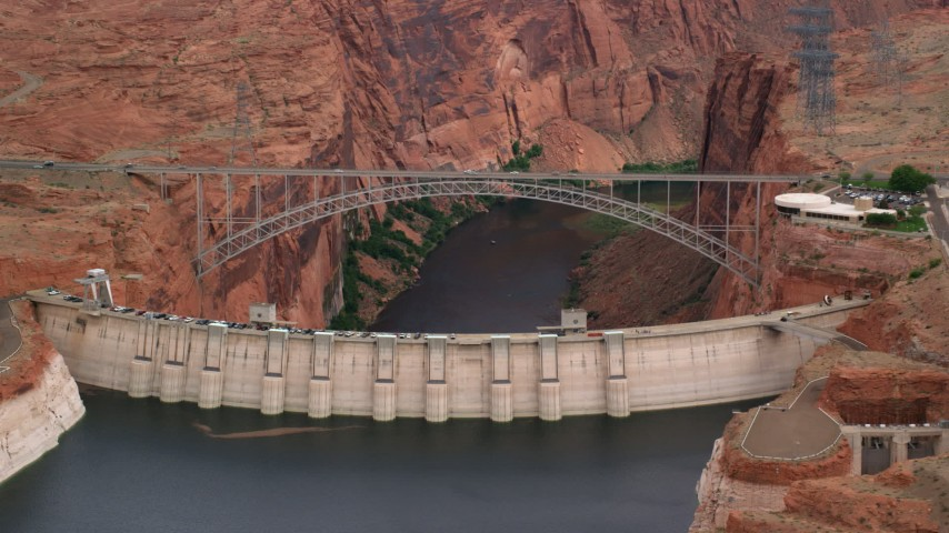 Flying by the Glen Canyon Dam and Bridge, Arizona Aerial Stock Footage | AX131_134