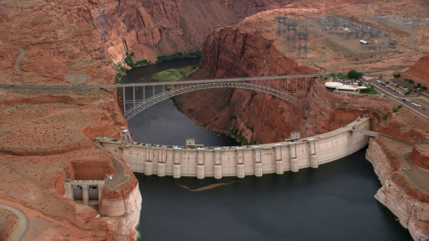 6K stock footage aerial video of flying by Glen Canyon Dam and Bridge, Arizona, zoom to wider view Aerial Stock Footage | AX131_135