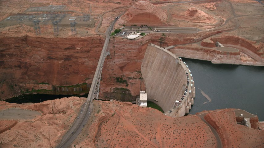 6K stock footage aerial video of an orbit of the Glen Canyon Dam and Bridge, Arizona Aerial Stock Footage | AX131_137