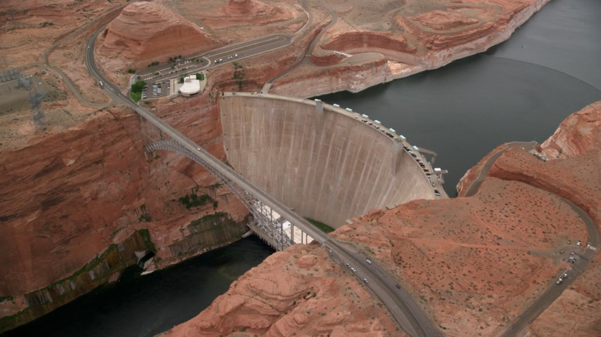 6K stock footage aerial video orbit around the Glen Canyon Dam and Bridge, Arizona Aerial Stock Footage AX131_138 | Axiom Images