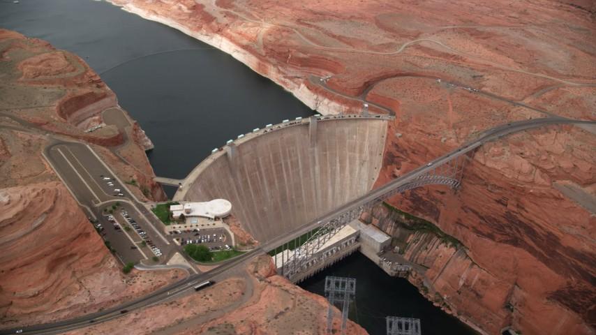 Orbiting the Glen Canyon Dam and Bridge, Arizona Aerial Stock Footage | AX131_140