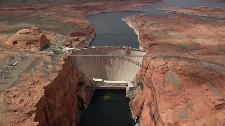 Following Colorado River, approaching the Glen Canyon Dam and Bridge, Arizona Aerial Stock Footage AX131_146