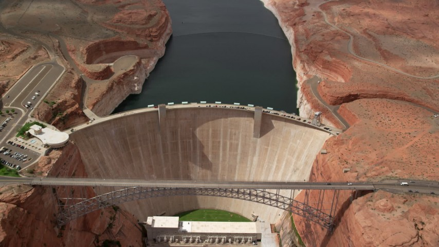 6K stock footage aerial video approach and tilt to bird's eye of bridge and dam, Lake Powell, Glen Canyon Dam and Bridge, Arizona Aerial Stock Footage AX131_147 | Axiom Images