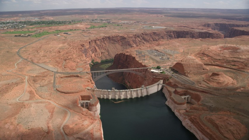 6K stock footage aerial video approach and tilt to Glen Canyon Dam, Glen Canyon Dam Bridge, Arizona Aerial Stock Footage | AX131_151