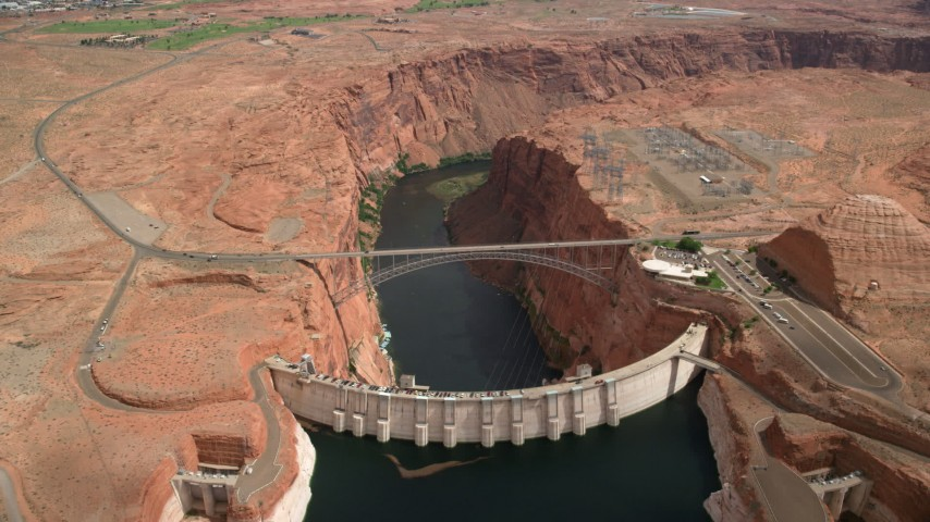 6K stock footage aerial video of flying over Colorado River, Glen Canyon Dam, and Glen Canyon Dam Bridge, Arizona Aerial Stock Footage | AX131_152
