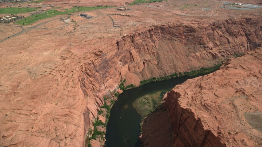 6K stock footage aerial video of flying over and panning across the Colorado River, Glen Canyon, Arizona Aerial Stock Footage | AX131_153