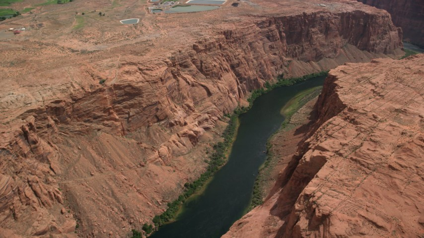 6K stock footage aerial video panning across the Colorado River while flying over Glen Canyon, Arizona Aerial Stock Footage | AX131_154