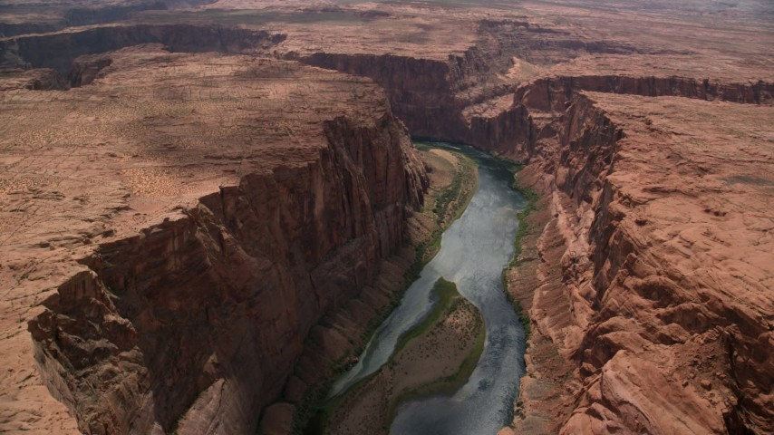 Flying by the Colorado River, Glen Canyon, Arizona Aerial Stock Footage | AX131_160