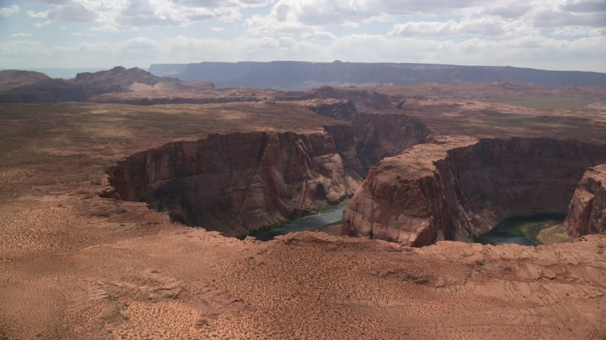 6K stock footage aerial video of flying by Horseshoe Bend and the Colorado River, Glen Canyon, Arizona Aerial Stock Footage | AX131_161