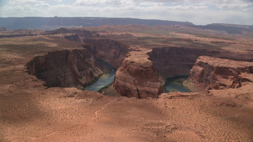 6K stock footage aerial video of flying by Horseshoe Bend, then away from Colorado River, Glen Canyon, Arizona Aerial Stock Footage | AX131_162