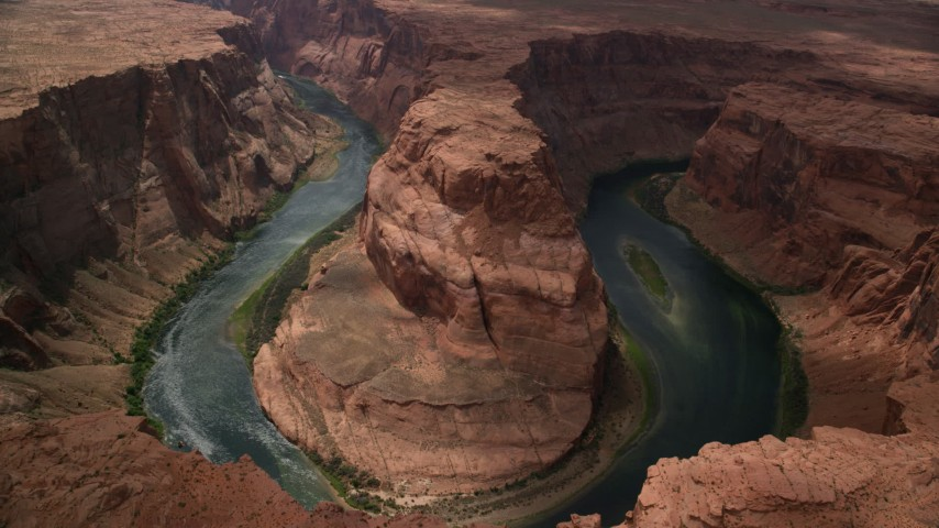 6K stock footage aerial video tilt to bird's eye view of Horseshoe Bend and Colorado River, Glen Canyon, Arizona Aerial Stock Footage | AX131_166
