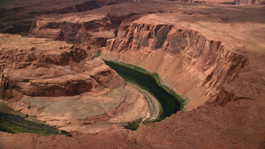 6K stock footage aerial video of flying away from Horseshoe Bend and the Colorado River in Glen Canyon, Arizona Aerial Stock Footage | AX131_170
