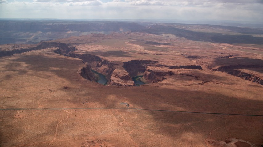 6K stock footage aerial video of a view of the Colorado River at the bottom of Horseshoe Bend, Glen Canyon, Arizona Aerial Stock Footage | AX131_172