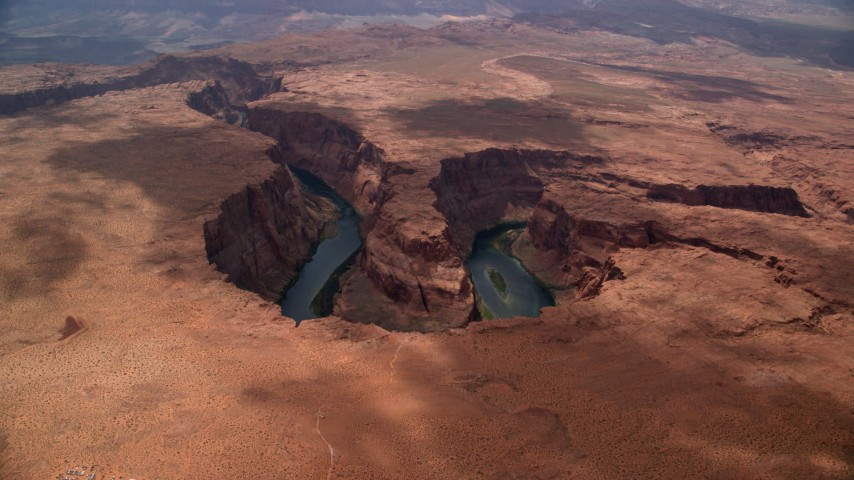 6K aerial stock footage video approach Horseshoe Bend, tilt to Colorado River, Glen Canyon, Arizona Aerial Stock Footage | AX131_175