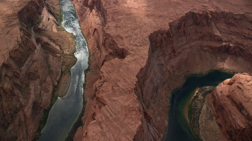 6K stock footage aerial video of flying over Horseshoe Bend, looking down at Colorado River, Glen Canyon, Arizona Aerial Stock Footage | AX131_179
