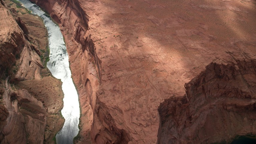 6K stock footage aerial video of a bird's eye view of Colorado River at the bottom of Glen Canyon, Arizona Aerial Stock Footage | AX131_180