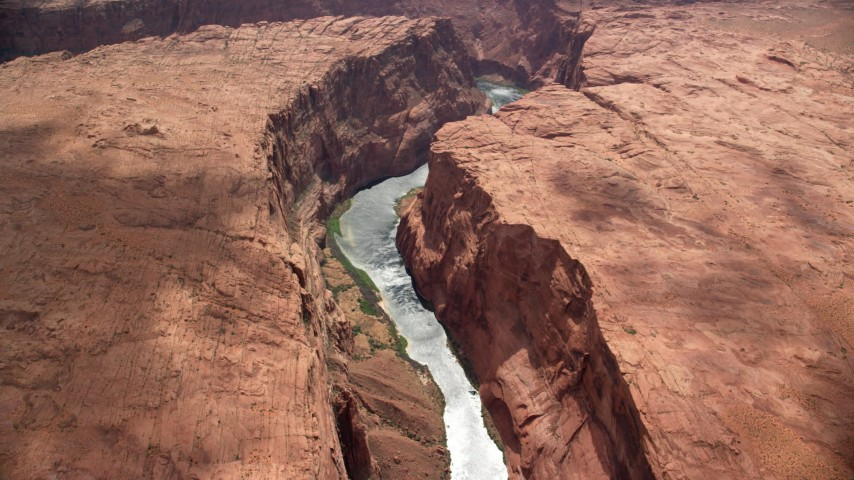 6K stock footage aerial video of flying by Colorado River flowing through Glen Canyon, Arizona Aerial Stock Footage | AX131_181