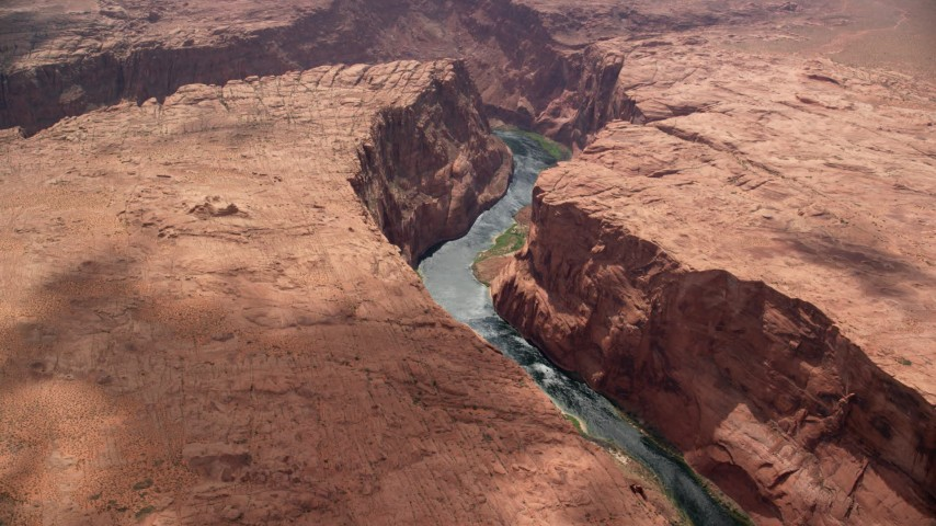 6K stock footage aerial video of flying by a bend in the Colorado River at the bottom of Glen Canyon, Arizona Aerial Stock Footage | AX131_182