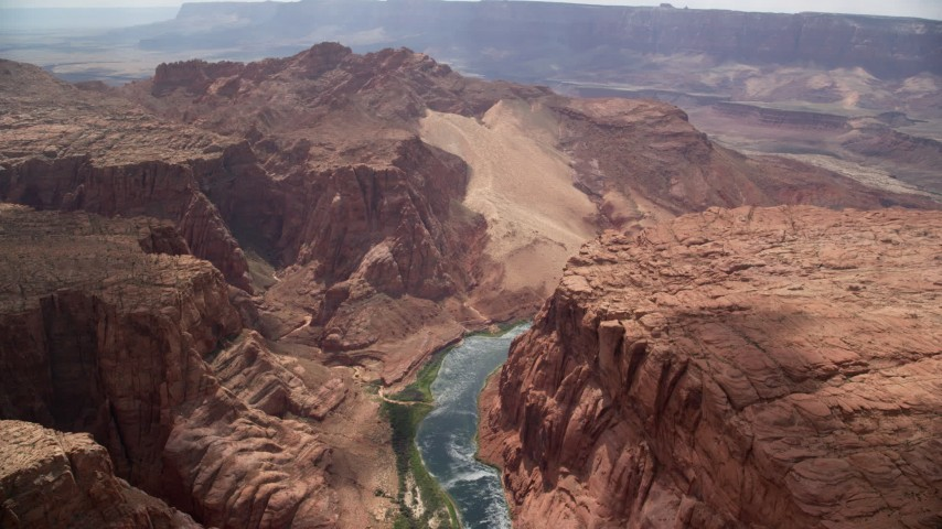 6K stock footage aerial video of following the Colorado River, bordered by rugged cliffs, Glen Canyon, Arizona Aerial Stock Footage | AX131_188