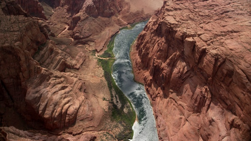 6K stock footage aerial video of a bird's eye view of Colorado River, rugged cliffs, Glen Canyon, Arizona Aerial Stock Footage AX131_189 | Axiom Images