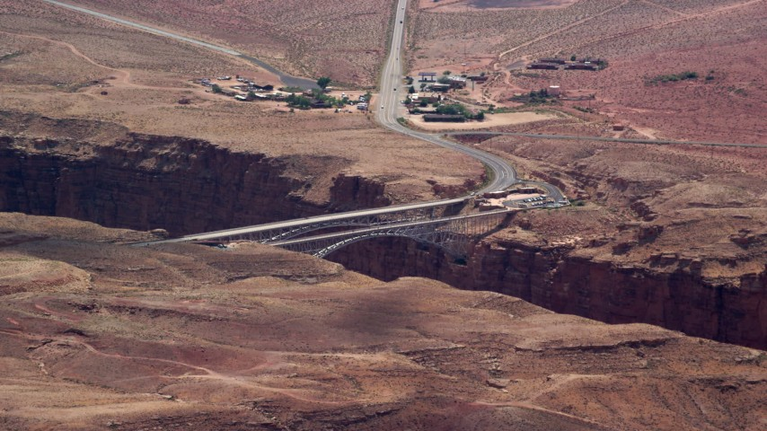 6K stock footage aerial video of flying by Navajo Bridge in Glen Canyon National Recreation Area, Utah, Arizona Aerial Stock Footage | AX131_196