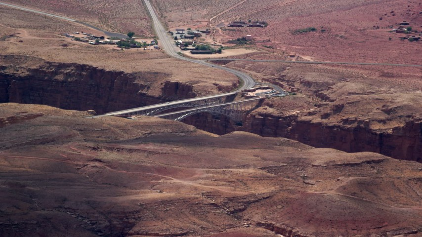 6K stock footage aerial video of a view of Navajo Bridge spanning Marble Canyon, Glen Canyon National Recreation Area, Utah, Arizona Aerial Stock Footage | AX131_197