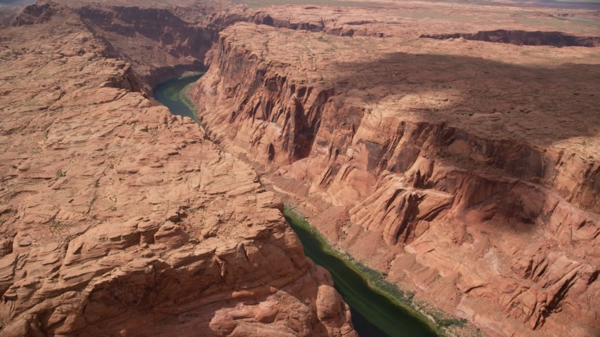 6K stock footage aerial video of flying by Colorado River, flowing through Glen Canyon, Arizona Aerial Stock Footage | AX131_201