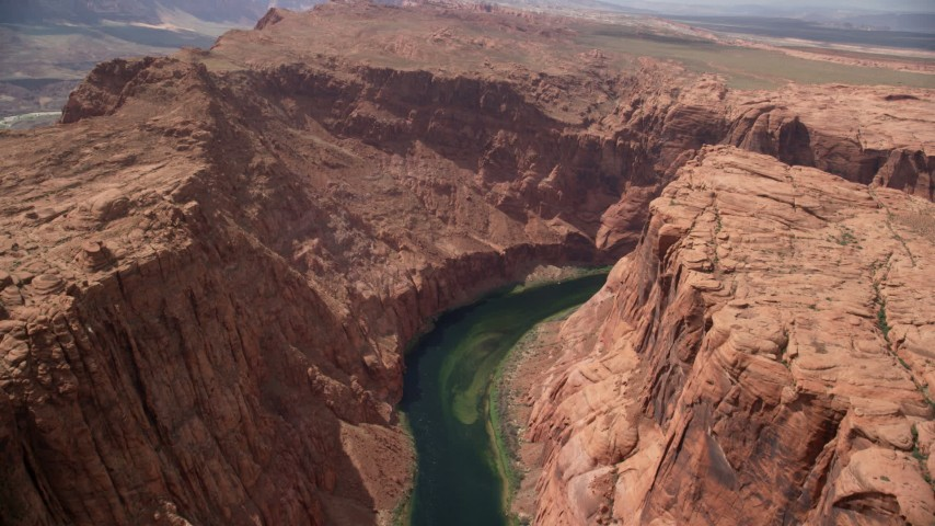 6K stock footage aerial video fly over Colorado River through Glen Canyon, Arizona Aerial Stock Footage | AX131_204