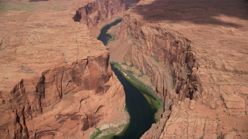 6K stock footage aerial video of passing by Colorado River running through Glen Canyon, Arizona Aerial Stock Footage | AX131_207