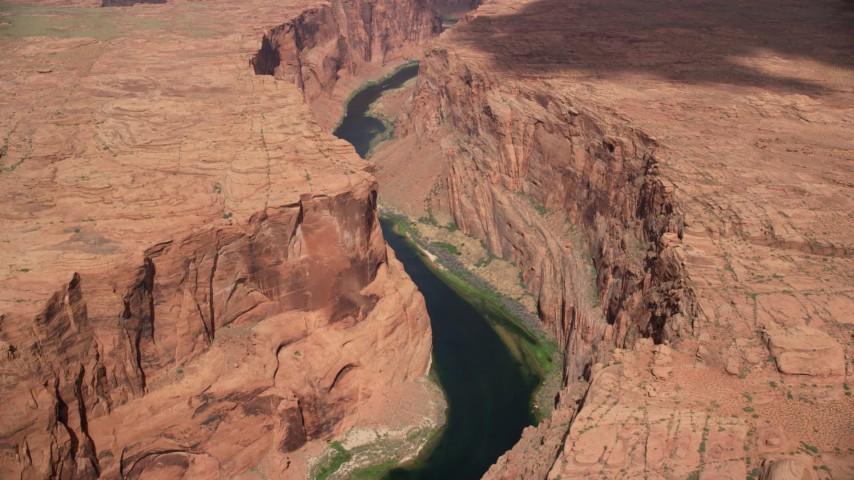 Flying by Colorado River, Glen Canyon, Arizona Aerial Stock Footage | AX131_207