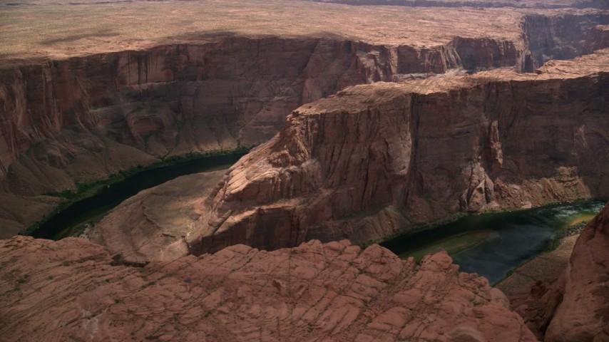 Flying by Horseshoe Bend, Colorado River, Glen Canyon, Arizona Aerial Stock Footage | AX131_218