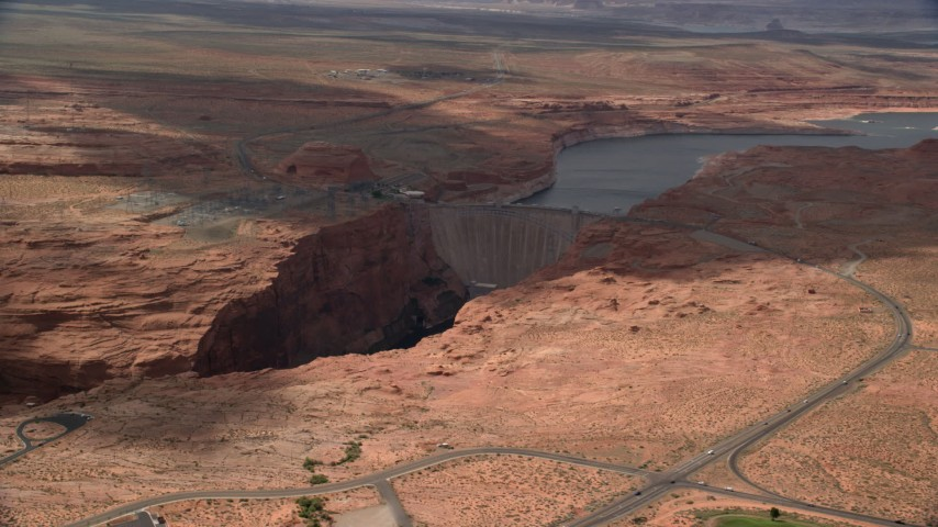 6K stock footage aerial video of flying by roads near the Glen Canyon Dam and Bridge, Arizona Aerial Stock Footage | AX131_224