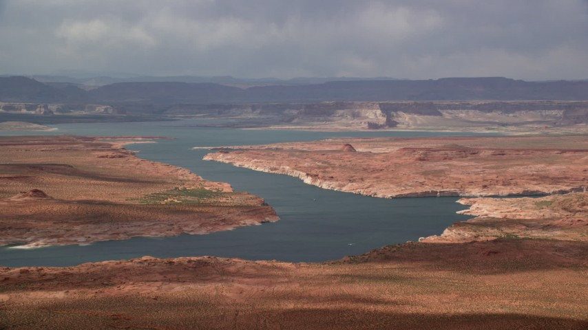 6K stock footage aerial video of passing Lake Powell, mesas in the background, Utah, Arizona Aerial Stock Footage | AX131_227