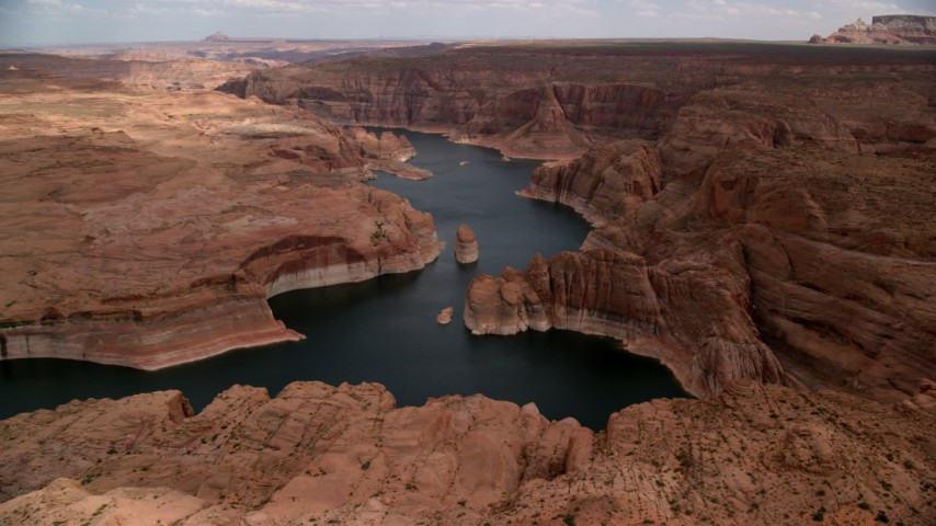 Approaching Lake Powell, cliffs, rock formations, Navajo Canyon, Arizona  Aerial Stock Footage | AX131_228