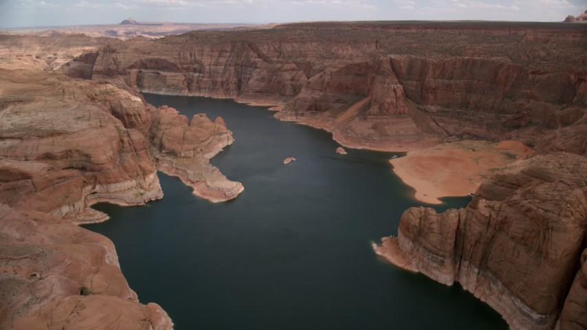 Flying over Lake Powell, Navajo Canyon, Arizona  Aerial Stock Footage | AX131_230